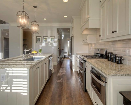 Wonderful Example Of A Kitchen Design In Other With An Undermount Sink, Granite  Countertops And An