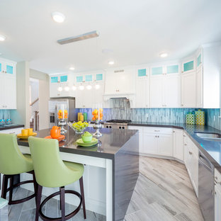 Large classic u-shaped kitchen/diner in Salt Lake City with a double-bowl sink, shaker cabinets, white cabinets, grey splashback, matchstick tiled splashback, stainless steel appliances, an island, composite countertops and ceramic flooring.