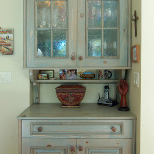 Design ideas for a large traditional u-shaped eat-in kitchen in San Luis Obispo with raised-panel cabinets, green cabinets, wood benchtops, beige splashback, coloured appliances, medium hardwood floors and with island.