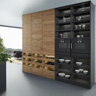 Idéer för stora funkis linjära kök och matrum, med en dubbel diskho, släta luckor, grå skåp, bänkskiva i koppar, brunt stänkskydd, rostfria vitvaror, betonggolv och en köksö