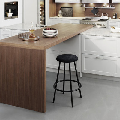 Example of a large minimalist l-shaped concrete floor eat-in kitchen design in New York with shaker cabinets, white cabinets, laminate countertops, brown backsplash, stainless steel appliances, a peninsula and a farmhouse sink
