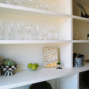 This is an example of a transitional kitchen pantry in Austin with open cabinets, white cabinets and quartzite benchtops.