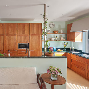Contemporary open concept kitchen ideas - Inspiration for a contemporary l-shaped beige floor open concept kitchen remodel in DC Metro with shaker cabinets, medium tone wood cabinets, soapstone countertops, stainless steel appliances, an island and multicolored countertops
