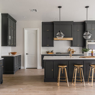 Large transitional kitchen designs - Example of a large transitional l-shaped beige floor kitchen design in Oklahoma City with an undermount sink, shaker cabinets, black cabinets, gray backsplash, stainless steel appliances, an island and gray countertops