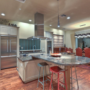 Eclectic kitchen photo in Houston with granite countertops and stainless steel appliances