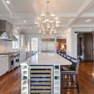 Inspiration for a transitional l-shaped dark wood floor open concept kitchen remodel in DC Metro with an undermount sink, shaker cabinets, white cabinets, marble countertops, gray backsplash, stainless steel appliances, an island and marble backsplash