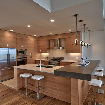 Open concept kitchen - mid-sized contemporary u-shaped medium tone wood floor open concept kitchen idea in Other with a double-bowl sink, flat-panel cabinets, medium tone wood cabinets, beige backsplash and stainless steel appliances