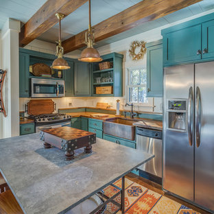 Kitchen - farmhouse l-shaped kitchen idea in Atlanta with a farmhouse sink, shaker cabinets, blue cabinets, stainless steel appliances and an island