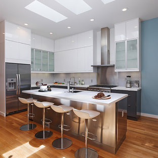 Contemporary l-shaped kitchen in San Francisco with flat-panel cabinets and stainless steel appliances.