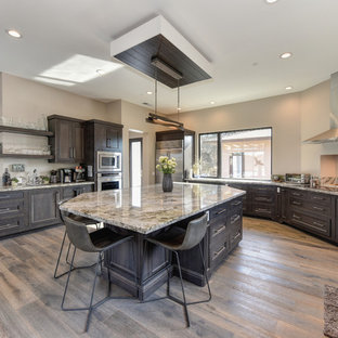 Rustic kitchen designs - Example of a mountain style u-shaped dark wood floor and brown floor kitchen design in Sacramento with shaker cabinets, dark wood cabinets, stainless steel appliances, an island and gray countertops