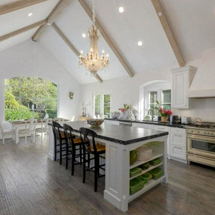 Inspiration for a shabby-chic style kitchen in Santa Barbara with recessed-panel cabinets, white cabinets, soapstone benchtops and with island.