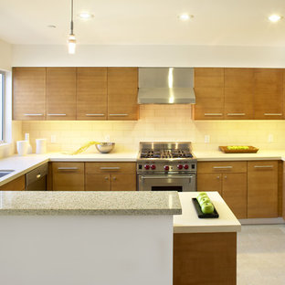 Mid-sized modern enclosed kitchen remodeling - Mid-sized minimalist u-shaped ceramic floor and beige floor enclosed kitchen photo in San Francisco with stainless steel appliances, a single-bowl sink, flat-panel cabinets, medium tone wood cabinets, quartzite countertops, white backsplash, subway tile backsplash and a peninsula