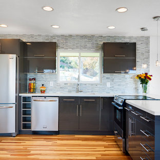 Design ideas for a contemporary l-shaped kitchen in Denver with concrete benchtops, stainless steel appliances, flat-panel cabinets, grey cabinets, matchstick tile splashback and multi-coloured splashback.