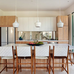 Mid-sized contemporary eat-in kitchen inspiration - Mid-sized trendy single-wall marble floor eat-in kitchen photo in Other with a double-bowl sink, quartz countertops, stainless steel appliances, an island, flat-panel cabinets, white cabinets and glass sheet backsplash