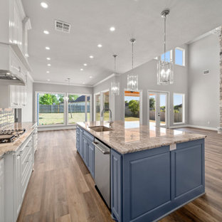 Design ideas for a large traditional l-shaped open plan kitchen in Austin with a single-bowl sink, shaker cabinets, white cabinets, granite benchtops, grey splashback, porcelain splashback, stainless steel appliances, vinyl floors, with island, brown floor and brown benchtop.