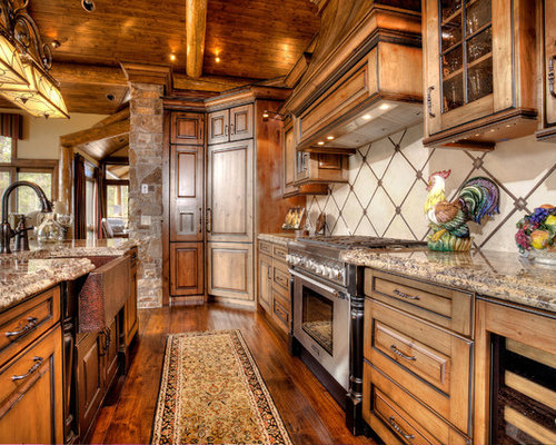 mountain style kitchen photo in denver with a farmhouse sink and granite countertops - Jeffrey Alexander Hardware