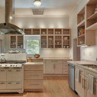 Traditional separate kitchen in Austin with a triple-bowl sink, open cabinets, white cabinets, white splashback, light hardwood floors and with island.