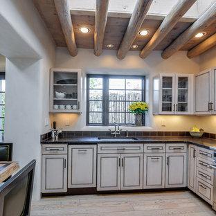 Southwestern kitchen designs - Inspiration for a southwestern kitchen remodel in Albuquerque