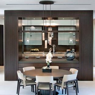 Inspiration for a large contemporary galley eat-in kitchen in Miami with louvered cabinets, grey cabinets, travertine floors, white floor, with island, a drop-in sink, marble benchtops, brown splashback, timber splashback and stainless steel appliances.