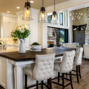 Huge farmhouse open concept kitchen designs - Example of a huge cottage medium tone wood floor and beige floor open concept kitchen design in Portland with a farmhouse sink, shaker cabinets, white cabinets, quartz countertops, green backsplash, ceramic backsplash, paneled appliances, an island and yellow countertops