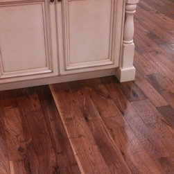 """5"""" & 7"""" Hand scraped walnut Woca oil finish - 5"""" & 7"""" x 3/4"""" Pre finished, Hand scraped American walnut plank flooring. Each plank meticulously hand scraped one at a time, by hand, not machined. Finished with 2 coats of WOCA UV oil finish from Denmark, an all natural, 0-VOC finish."""