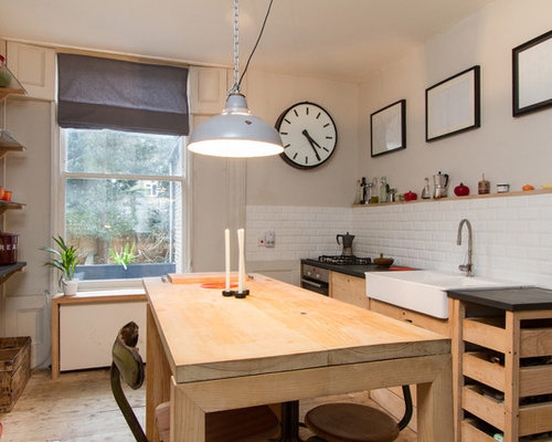 1960s Kitchen Photo In London With Subway Tile Backsplash And A Farmhouse  Sink