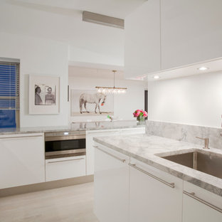 Example of a trendy kitchen design in New York with stainless steel appliances and granite countertops