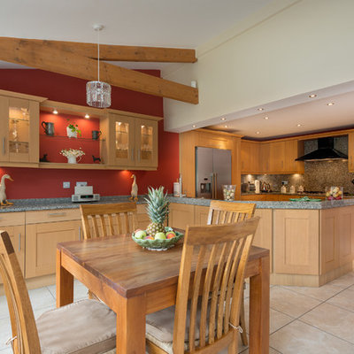Inspiration for a timeless eat-in kitchen remodel in Devon with shaker cabinets, light wood cabinets and stainless steel appliances