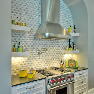Large contemporary eat-in kitchen ideas - Inspiration for a large contemporary u-shaped dark wood floor eat-in kitchen remodel in Austin with an undermount sink, shaker cabinets, white cabinets, granite countertops, gray backsplash, porcelain backsplash, white appliances and two islands