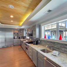 Beach Style Kitchen by Emerald Coast Real Estate Photography