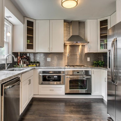 Example of a transitional u-shaped kitchen design in Chicago with stainless steel appliances, an undermount sink, shaker cabinets, white cabinets, metallic backsplash and mosaic tile backsplash