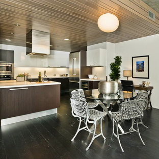 Open concept kitchen - mid-sized contemporary u-shaped dark wood floor open concept kitchen idea in San Francisco with stainless steel appliances, an integrated sink, flat-panel cabinets, dark wood cabinets, quartz countertops, white backsplash and an island