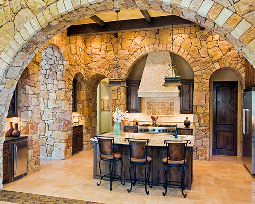 Superior Tuscan L Shaped Kitchen Photo In Austin With Raised Panel Cabinets, Dark  Wood