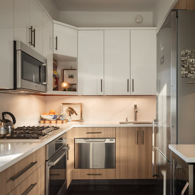 Small transitional u-shaped ceramic tile and black floor eat-in kitchen photo in New York with an undermount sink, flat-panel cabinets, light wood cabinets, quartz countertops, white backsplash, marble backsplash, stainless steel appliances, no island and gray countertops