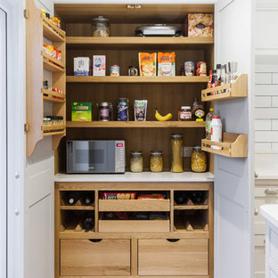 Design ideas for a medium sized classic kitchen pantry in Essex with white worktops and light hardwood flooring.