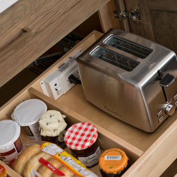 A Breakfast Center Station in a Base Cabinet with Powered Roll-Out Shelves
