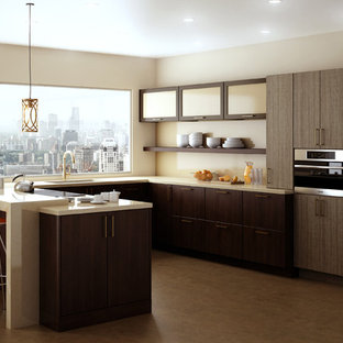 Mid-sized contemporary eat-in kitchen ideas - Example of a mid-sized trendy u-shaped cork floor and brown floor eat-in kitchen design in New York with an undermount sink, dark wood cabinets, solid surface countertops, beige backsplash, glass sheet backsplash, stainless steel appliances, a peninsula and flat-panel cabinets