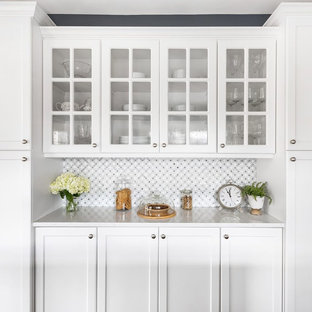 Inspiration for a traditional kitchen/diner in Minneapolis with a submerged sink, white cabinets, quartz worktops, grey splashback, metro tiled splashback, an island and blue worktops.