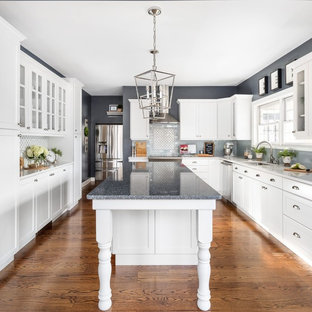 Design ideas for a traditional u-shaped eat-in kitchen in Minneapolis with an undermount sink, white cabinets, quartzite benchtops, grey splashback, subway tile splashback, with island, blue benchtop, shaker cabinets, medium hardwood floors and brown floor.