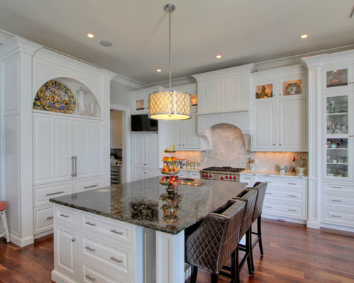 Traditional medium tone wood floor eat-in kitchen idea in Atlanta with  granite countertops,