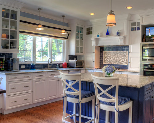 Traditional Kitchen Idea In Newark With Raised Panel Cabinets White Blue Backsplash