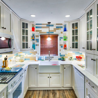 Inspiration for a small transitional u-shaped separate kitchen in Other with a farmhouse sink, quartz benchtops, multi-coloured splashback, ceramic splashback, white appliances, no island, recessed-panel cabinets, beige cabinets, dark hardwood floors and brown floor.