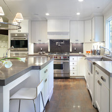 Contemporary Kitchen by Kenneth Davis Lux International