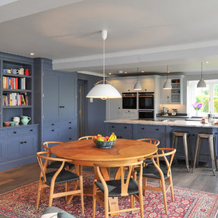 Design ideas for a large traditional open plan kitchen in Hampshire with blue cabinets, granite worktops and an island.
