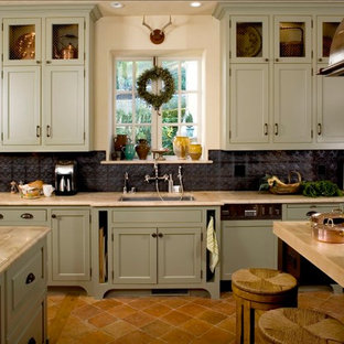 Elegant kitchen photo in San Francisco with shaker cabinets, green cabinets and metal backsplash