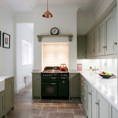 Mid-sized trendy galley limestone floor enclosed kitchen photo in Kent with a farmhouse sink, shaker cabinets, quartzite countertops, white backsplash, colored appliances, green cabinets, subway tile backsplash and white countertops