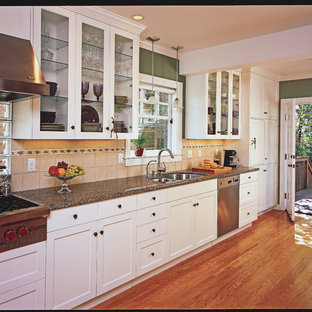 Mid-sized craftsman eat-in kitchen designs - Inspiration for a mid-sized craftsman galley medium tone wood floor eat-in kitchen remodel in San Francisco with an undermount sink, shaker cabinets, white cabinets, granite countertops and stainless steel appliances