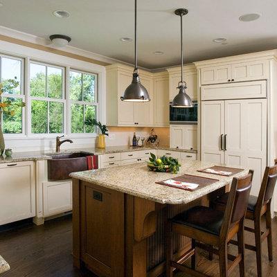 Kitchen - craftsman u-shaped kitchen idea in Chicago with a farmhouse sink, shaker cabinets, beige cabinets, granite countertops, white backsplash, subway tile backsplash and paneled appliances