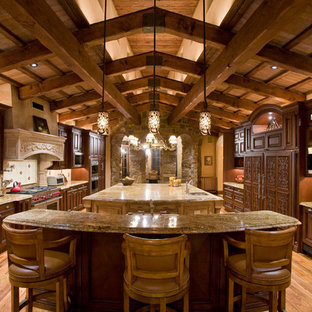 Large rustic eat-in kitchen appliance - Example of a large mountain style galley light wood floor eat-in kitchen design in Phoenix with an undermount sink, open cabinets, dark wood cabinets, granite countertops, beige backsplash, porcelain backsplash, stainless steel appliances and two islands