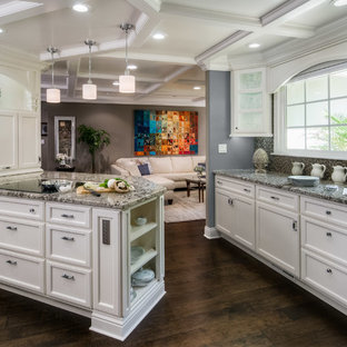 Mid-sized traditional enclosed kitchen designs - Enclosed kitchen - mid-sized traditional u-shaped dark wood floor and brown floor enclosed kitchen idea in San Francisco with recessed-panel cabinets, white cabinets, multicolored backsplash, mosaic tile backsplash, stainless steel appliances, a peninsula and granite countertops